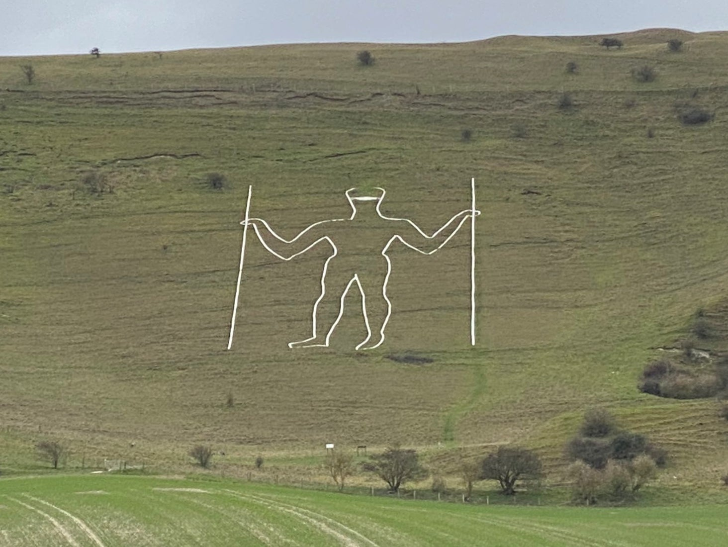 Vandals paint Covid mask on 235ft Long Man of Wilmington