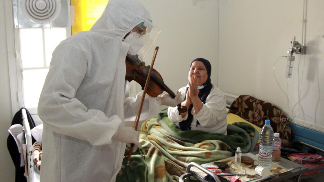 Tunisian doctor plays violin to boost virus patients' morale | World
