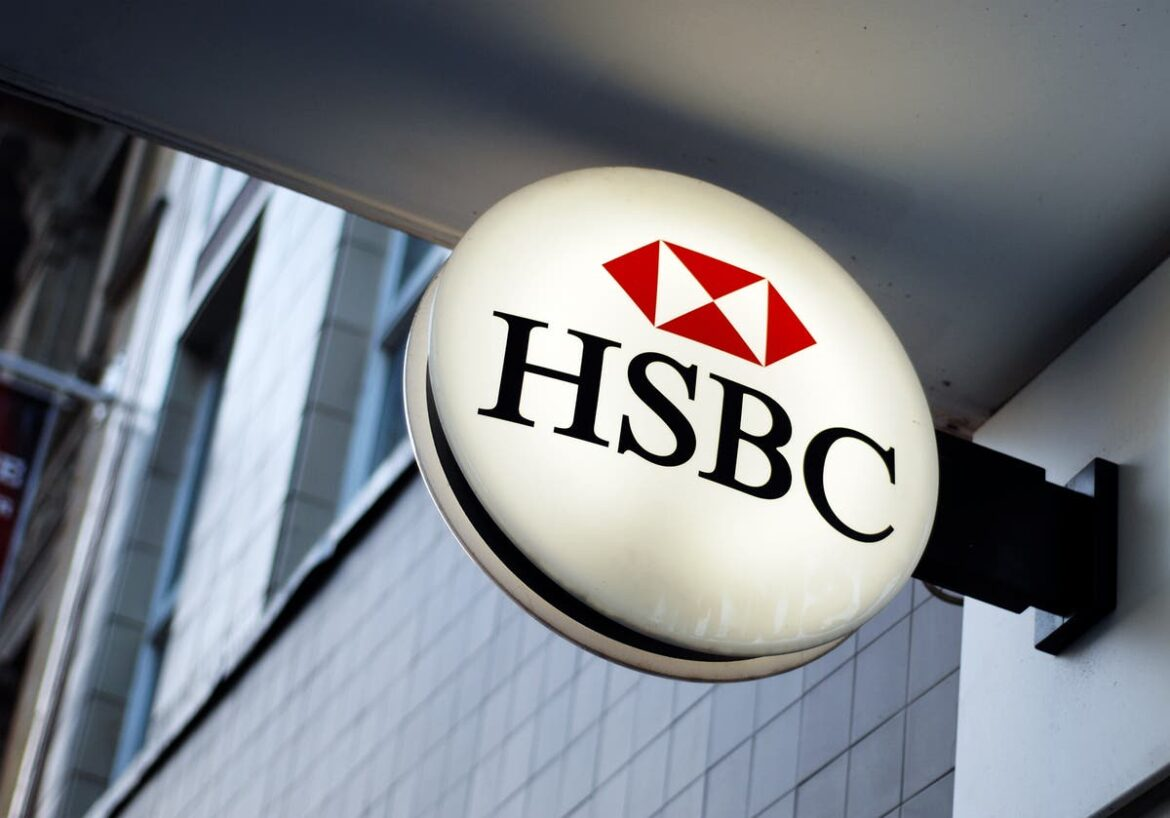 HSBC to cut jobs and resume dividend payments as profits slump by a third