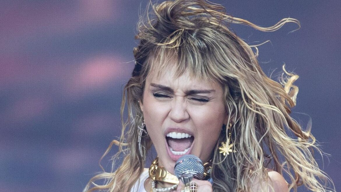 Emotional Miley Cyrus fights back tears during pre-Super Bowl performance