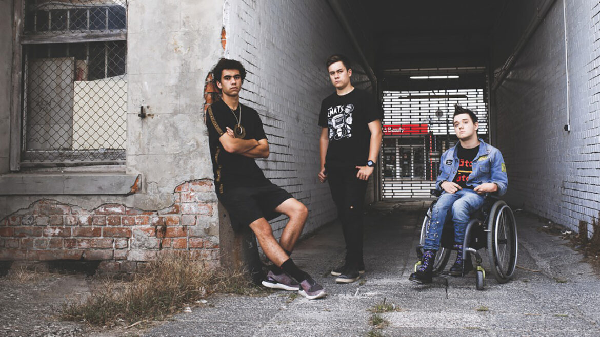 Victorian punk rockers Sit Down In Front sign with Native Tongue